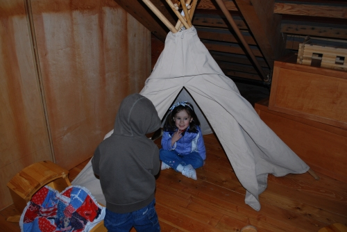 Playing in the Teepee at This Is The Place's shop.