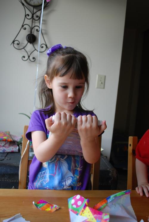 "Inspecting her ""Barbie as Rapunzel"" movie."